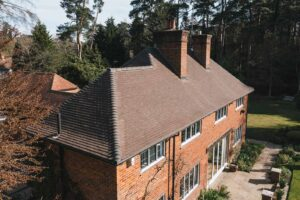 Strip and replace french weathered clay tiles
